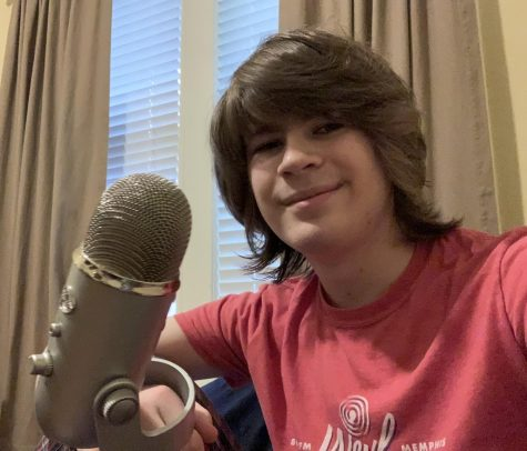 "Jasper Liles (11) prepares to record himself at home. Liles voice acts and currently is the voice for the University of Memphis's ""Wellness Wednesday"" program."