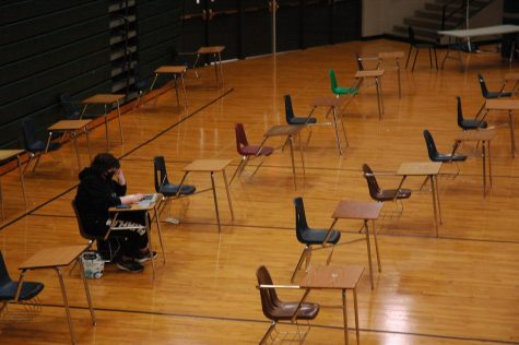 The senior gym is lined with desks for returning students, yet only three seats were taken in this study hall. Out of 2,205 enrolled students, only 180 returned for in-person learning, sparking feelings of isolation for those that came back.
