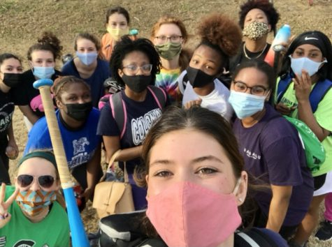 Bella Canale (11) poses with the softball team for a quick post-practice selfie. Wearing masks is one of multiple COVID-19 precautions the team has to take at practices and games.