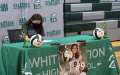 Sarah Hardin autographs a letter of intent at her signing party. In the fall she will attend Trevecca Nazarene University, where she received an athletic scholarship for their volleyball team.