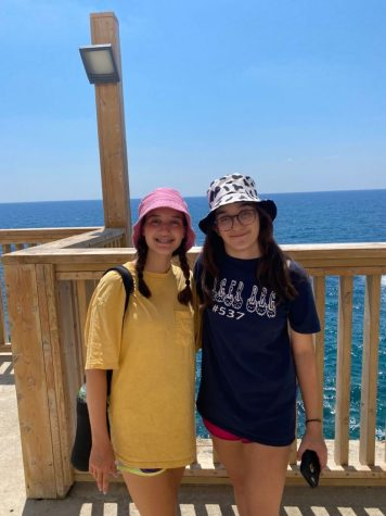 Abby and Mandy Cassius (12) pose near Achziv beach after learning about the Rosh Hanikra grottoes. This was one of their many stops during their month-long vacation in Israel.