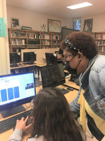 Mrs. Harden helps a student with an assignment for her new class, Fundamentals of Teaching. This class is a recent addition to the WSHS curriculum, which allows students to explore teaching as a profession.