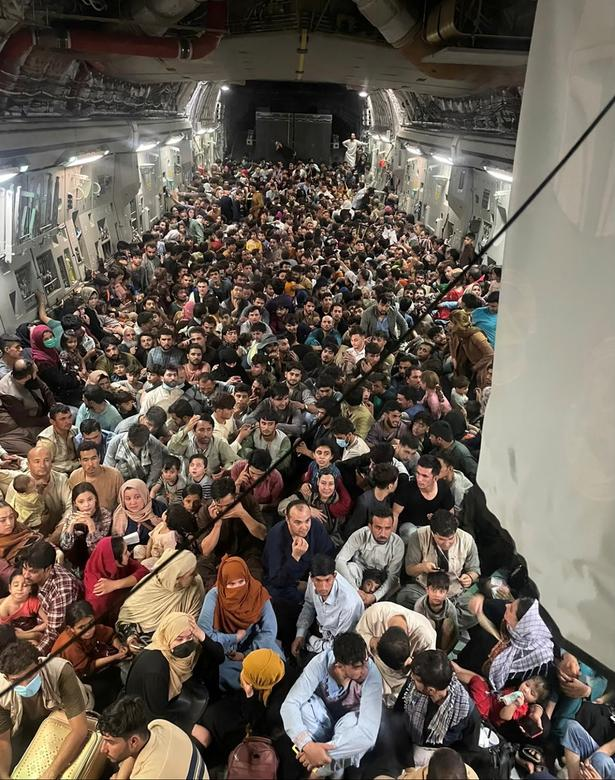 Afghan citizens are pictured crowding the Kabul Airport in a scramble to flee their country. Their home is left in a state of terror following the Taliban's seizure of power.