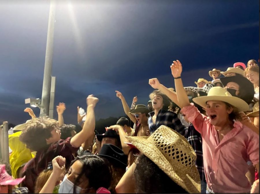 The student section, who is decked out in their cowboy gear, lets out a roar of excitement to cheer for the football team at the White Station vs Collierville game on Friday, Sept. 3, 2021. With this close proximity and eruption of movement comes the question of whether or not masks should be worn at games.